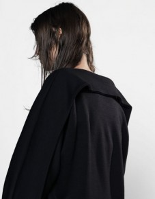 Black geometrical shapes coat