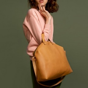 Madura aged yellow leather hand bags